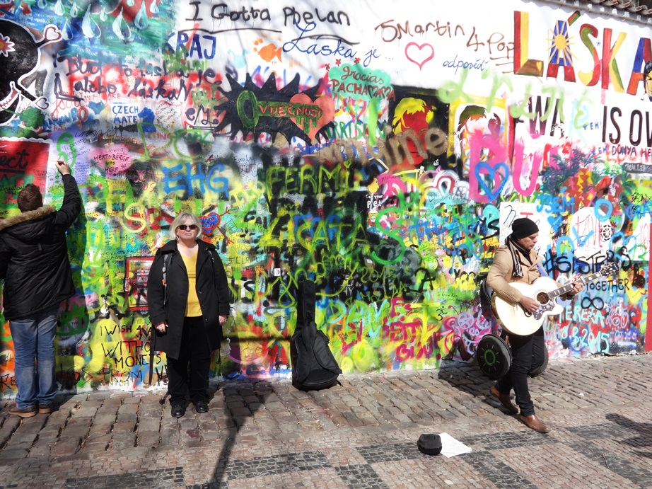 The Lennon Wall, Prague. It was supposed to be the Lenin Wall, but after Communism fell, young people started painting graffiti on it, and I think (maybe?) John Lennon visited it, so they began calling it the Lennon Wall instead. Graffiti continually refreshed.